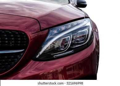 Closeup headlights of ca and Car exterior detail with White backCloseup headlights of car. Modern luxury car close-up banner background. Concept of expensive, sports auto Closeup headlights
