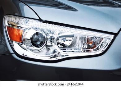 Closeup headlights of car.