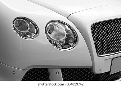 Closeup headlights of luxury car. Car exterior detail.