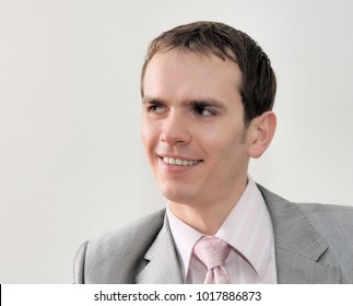Closeup headshot portrait, serious, handsome, confident, young business man isolated on white background/Portrait of young nice businessman isolated on white background