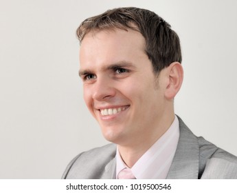 Closeup headshot portrait, serious, handsome, confident, young business man isolated on white background/Portrait of a nice businessman isolated