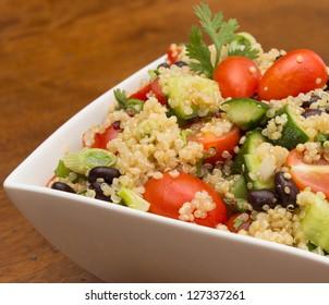 Closeup of healthy quinoa salad with fresh vegetables