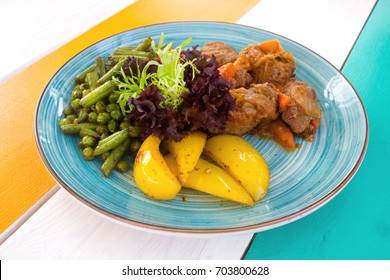 Closeup of healthy vegetables with meat on the plate in the restaurant