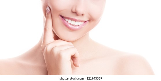 closeup of the healthy white teeth of a woman, isolated against white background