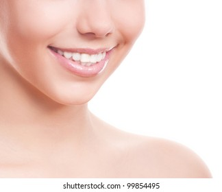 closeup of the healthy white teeth of a woman, isolated against white background, copyspace for your text to the right