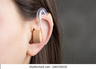 Close-up Of Hearing Aid In The Ear Of A Girl