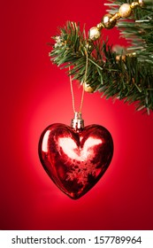 Close-up Of Heart Shape Bauble On Christmas Tree