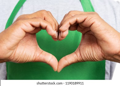 Close-up of heart shaped love gesture made by supermarket or hypermarket employee isolated on white background
