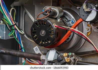 Closeup of heater exhaust fan inside of furnace. Concept of HVAC maintenance, repair, service and installation