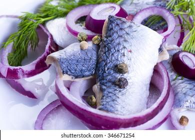 Closeup of herrings on plate