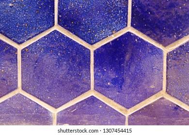 Close-up of hexagonal wall tiles.