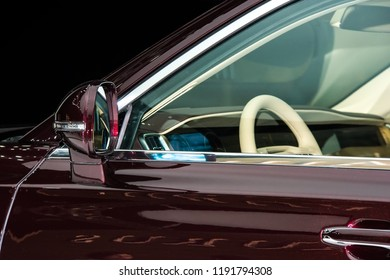 Closeup high-detailed view on rearview mirror of luxury car
