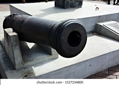 Closeup historic cannon on display harbor of Lahaina Maui set on concrete pad background