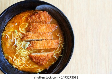 Closeup of Hokkaido Ramen in a wooden bowl . Ramen is a noodle soup dish that was originally imported from China and has become one of the most popular dishes in Japan in recent decades
