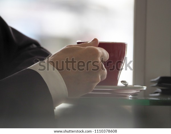 Close-up Holding cup of coffee in hand,