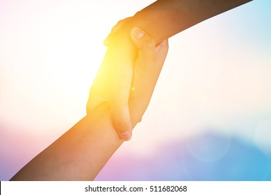 Closeup holding hand Used to help each other on background. Union hands strong who have experience to help support the people who are able to move on to survive african with happy integrating concept.