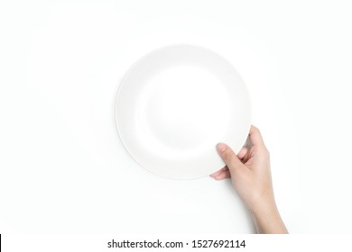 Close-up, holding a white plate on a white background. Isolated background.