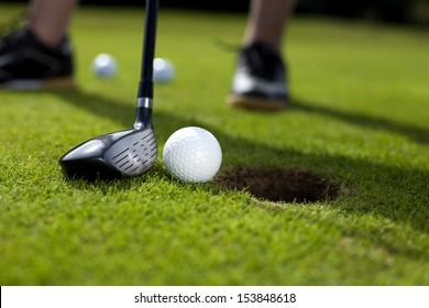 Closeup of hole on golf field