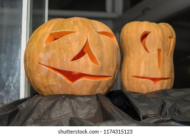 close-up of holloween pumpkin at night. lighten from the inside at a holloween party. fresh Pumpkin curved