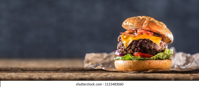 Close-up home made beef burger on wooden table.