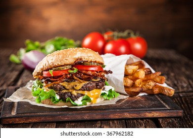 Close-up of home made burgers on wooden background