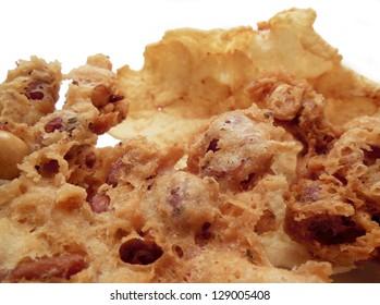 Close-up of homemade rempeyek, deep fried Indonesian peanut cracker and krupuk emping