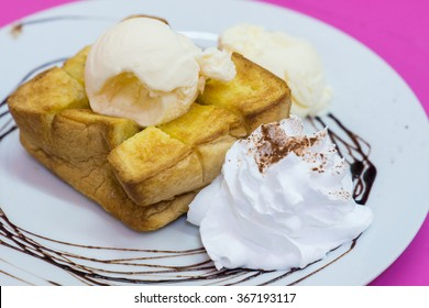 Close-up honey toast with vanilla ice cream.