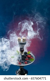 Closeup of hookah with tray full of berries