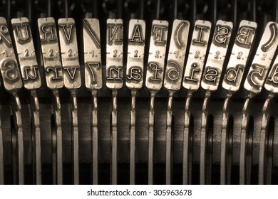 Close-up Horizontal Photograph of Used Metal Typebars