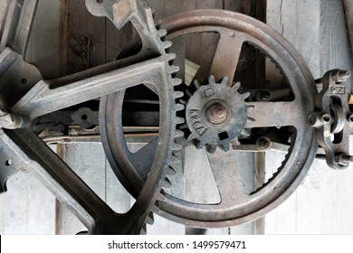 close-up of horse mil with flywheel and gears visiblel, a horse powered mill used in the past to grind
