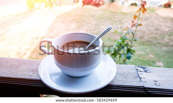 Closeup hot coffee in white ceramic cup.