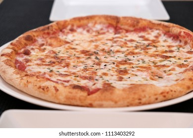 Close Up Of Hot Four Cheese Pizza On Table At Restaurant.