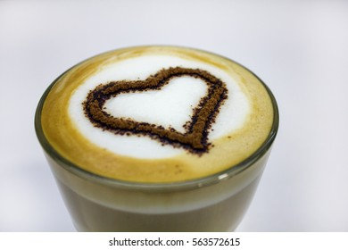 closeup of hot tasty coffee with foam decorated with heart