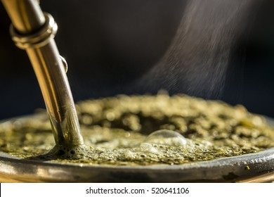 Close-Up Of Hot Traditional South American Caffeine-Rich Infused Drink Mate In A Calabash Gourd