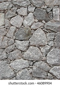 Closeup to a house rustic covering simulating a dry stone wall