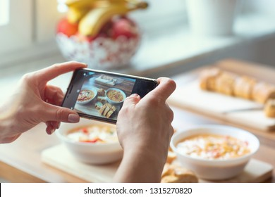 Closeup how womans hands taking photo of vegetarian food at home