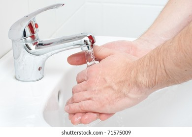 Close-up of human hands being washed