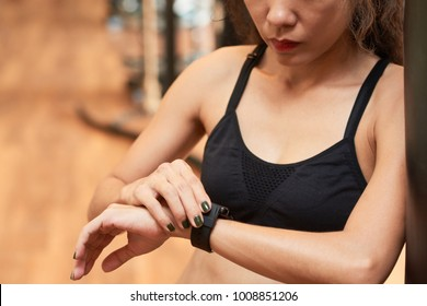Close-up iamge of fit woman setting her smart watch before training
