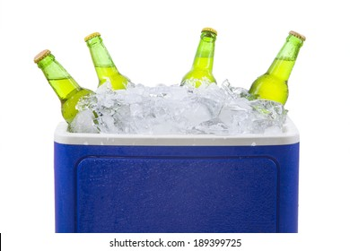 Closeup of an ice chest full of ice and assorted beer bottles. isolated on white