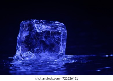 Closeup of a Ice cube on a dark background