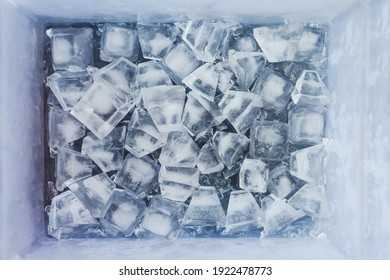 close-up of ice cubes in freezer tray with cold blue tones and contrasty tones
