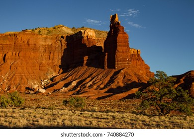 Close-up of iconic Chimney Rock in Capitol Reef National Park in Utah at sunset.