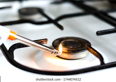 Close-up  of    Ignited flame on a spark gas igniter  .  Concept of gas shortage and crisis .
