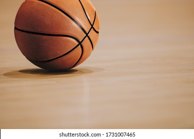 Close-up image of basketball ball over floor in the gym
