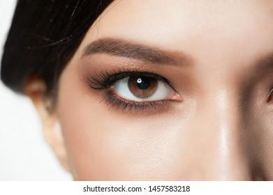 Closeup image of beautiful woman eye with bright makeup, macro.