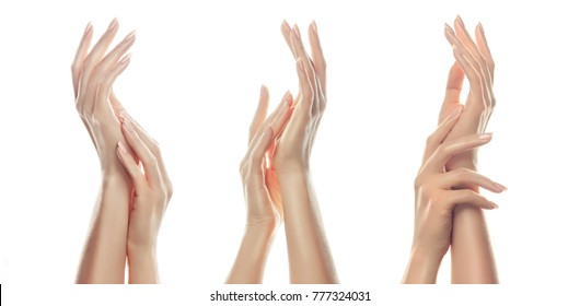 Closeup image of beautiful woman's hands with  light pink manicure on the nails. Cream for hands , manicure and beauty treatment.  Elegant and graceful arms with slender graceful fingers.