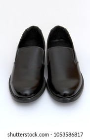 closeup image of black leather male shoes