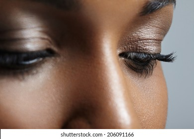 closeup image of black woman's eyes with nude makeup