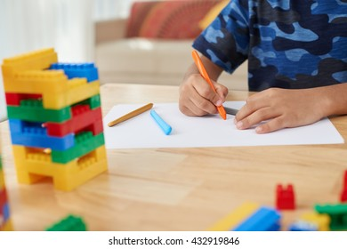 Close-up image of boy drawing with colorful pencils