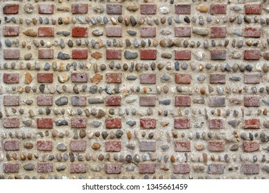 Close-up image of a brick and pebble wall